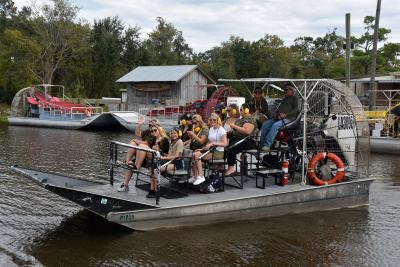 happy group on an airboat tour in Louisiana
